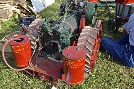 mini farm: ROLLAG, MINNESOTA, Sept 1. 2016: Unidentified man feeds coal into the boiler of miniature steam engines at the West Central Steam Threshers Reunion in Rollag, MN attended by 1000s held annually on Labor Day weekend. Editorial