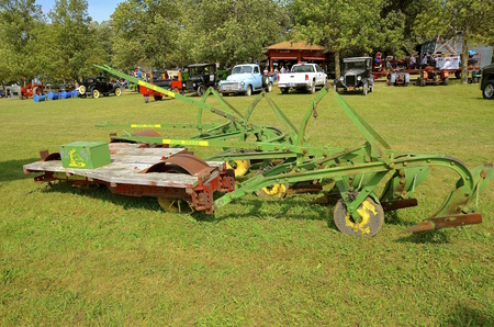 ROLLAG, MINNESOTA, September 1, 2016: A vintage John Deere platform plow pulled by a steam engine is displayed at the West Central Steam Threshers Reunion in Rollag, MN attended by 1000s held annually on Labor Day weekend.
