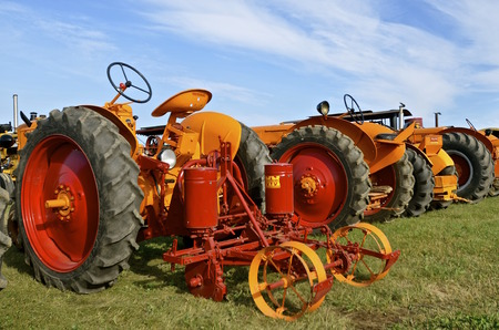 refurbished: ROLLAG, MINNESOTA, Sept 1. 2016: A Minneapolis Moline tractor attached to a refurbished corn planter is featured at the West Central Steam Threshers Reunion in Rollag, MN attended by 1000s held annually on Labor Day weekend. Editorial