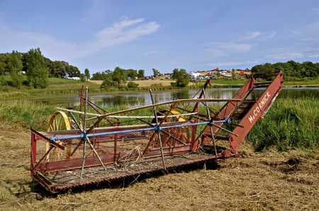 ROLLAG, MINNESOTA, Sept 1. 2016: A vintage McCormick small grain swather is displayed at the West Central Steam Threshers Reunion in Rollag, MN attended by 1000s held annually on Labor Day weekend.