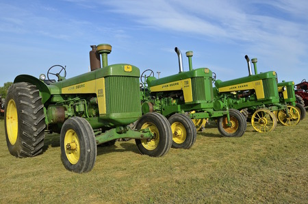 ROLLAG, MINNESOTA, Sept 1. 2016:Vintage John Deere 630, 730, and 830 tractors are displayed at the West Central Steam Threshers Reunion in Rollag, MN attended by 1000s held annually on Labor Day weekend.