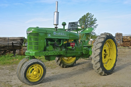 ROLLAG, MINNESOTA, Sept 1. 2016: A restored H Farmall painted John Deere green is displayed at the West Central Steam Threshers Reunion in Rollag, MN attended by 1000s held annually on Labor Day weekend.