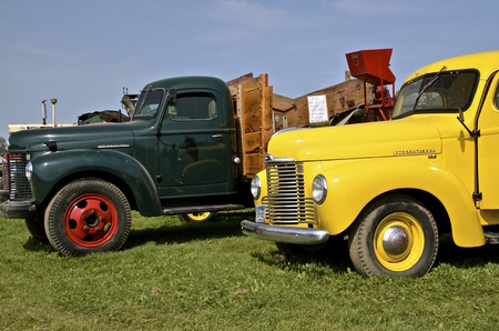 ROLLAG, MINNESOTA, Sept 1. 2016: Several refurbished International trucks are displayed at the West Central Steam Threshers Reunion in Rollag, MN attended by 1000s held annually on Labor Day weekend.