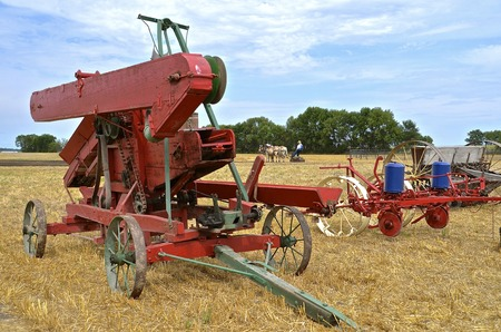 pitching: Old harvest equipment and methods demonstrated at a farm threshers show