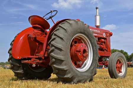 standard steel: ROLLAG, MINNESOTA, Sept 1. 2016: An old restored classic McCormick tractor is  displayed at the West Central Steam Threshers Reunion in Rollag, MN attended by 1000s held annually on Labor Day weekend.