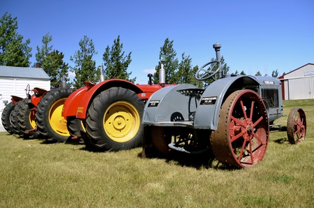 oldie: WATFORD CITY, NORTH DAKOTA, June 23, 2016: A vintage McCormick Deering, Massey Harris and other tractors are displayed at the Watford City Pioneer Museum which is open and free to the public.