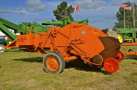 baler: ROLLAG, MINNESOTA, Sept 1. 2016: A restored Minneapolis Moline baler is displayed at the annual WCSTR farm show in Rollag held each Labor Day weekend where 1000s attend.