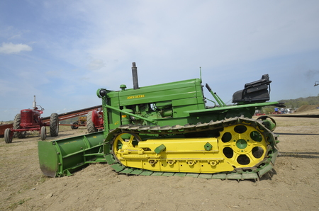deere: ROLLAG, MINNESOTA, Sept 1. 2016: A restored John Deere bulldozer tractor with a blade is displayed at the annual WCSTR farm show in Rollag held each Labor Day weekend where 1000s attend.