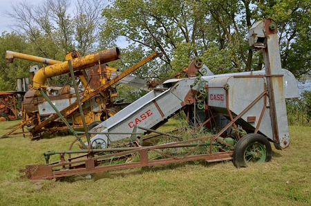 power operated: ROLLAG, MINNESOTA, Sept 1. 2016: An old Case  pull combine operated by power take-off is displayed at the annual WCSTR farm show in Rollag held each Labor Day weekend where 1000s attend annually