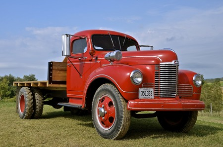 refurbished: ROLLAG, MINNESOTA, Sept 1. 2016: Old International on ton truck is displayed at the annual WCSTR farm show in Rollag held each Labor Day weekend where 1000s attend annually.