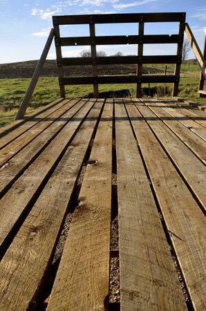 Wooden floor of a hayrack for hauling straw and hat bales