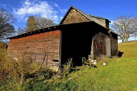 Old decrepit granary and storage shed amidst the colors for autumn