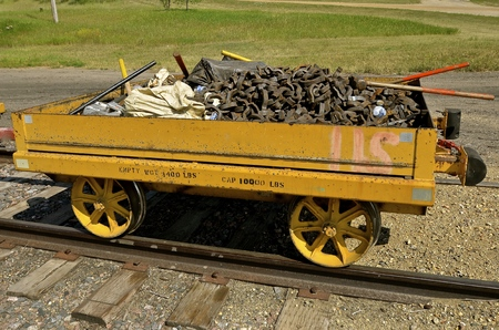 maul: An old railroad cart full of parts for repairing train tracks is loaded for usage