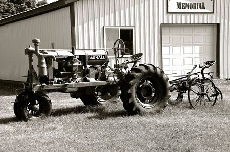 eventually: MEDINA, NORTH DAKOTA, June 1, 2016: The McCormick Deering F-12 Farmall tractor eventually became  opened by the American company know as International Harvester Co.