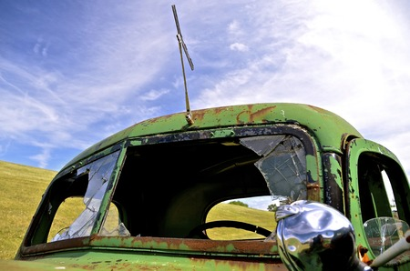 An old pickup with broken windshields is left for salvage and parts