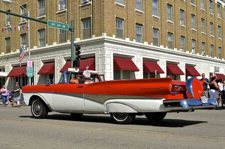 refurbished: MANDAN, NORTH DAKOTA, July 3, 2016: The 4th of July Rodeo Days  3 day celebration includes the rodeo, Art in the Park, and downtown 4th parade where this 1958 Ford Fairlane retractable convertible is featured.