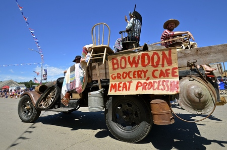 MANDAN, NORTH DAKOTA, July 3, 2016: The 4th of July Rodeo Days  3 day celebration includes the rodeo, Art in the Park, and downtown 4th parade where the Bowden Grocery Store advertises in a jalopy of the Depression ERA Editorial