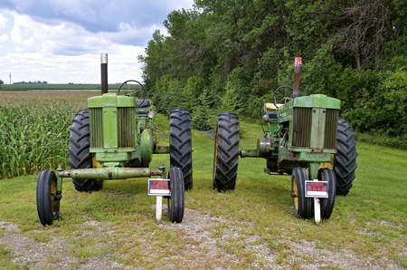 ULEN, MINNESOTA, July 27, 2016:The two old John Deere tractors for sale  are products of John Deere Co, an American corporation that manufactures agricultural, construction, forestry machinery, diesel engines, and drivetrains.