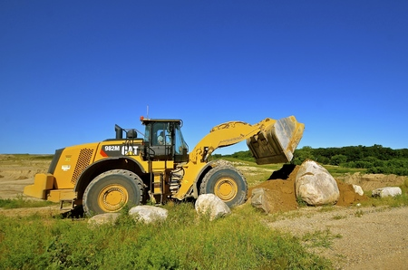 front end loader: HAWLEY, MINNESOTA, August 4, 2016; Founded in 1925, the 982 M Cat carrying sand is from Caterpillar Inc., an American corporation which designs, develops, engineers, manufactures, markets and sells machinery, engines, financial products and insurance Editorial