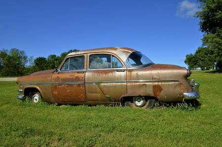 trashed: HAWLEY, MINNESOTA, August 4, 2016:  The old 1950s Ford Customliner Ford is a product of the Ford Motor Company located in Dearborn, Michigan started by Henry Ford and incorporated on June 16, 1903.