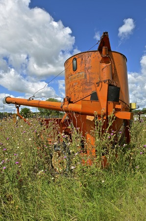 DETROIT LAKES, MINNESOTA, August 4, 2016. The  abandoned old Bear Cat Bearcat Grain King Grinder Mixers was manufactured by Western Land Roller Company, Hastings Nebraska in the early 1960s.