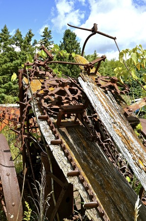 laths: Remnants of a very old corn picker included many gears, chain, and wooden laths.