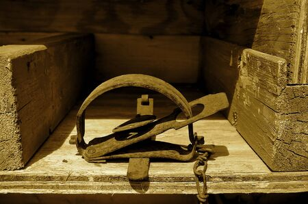 sprung: (sepia) An old vintage victor jump trap for catching rodents Stock Photo