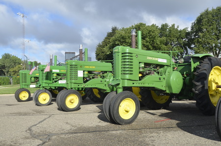 YANKTON, SOUTH DAKOTA, August 19, 2106: A series of restored vintage john Deere tractors are displayed at the annual Riverboat Days celebrated the third weekend of August Editorial