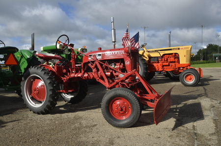 August 19, 2106: A restored vintage john Deere tractor Farmall Cub tractor with a blade is displayed at the annual Riverboat Days celebrated the third weekend of August Editorial
