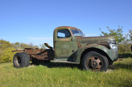 East Grand Forks, Minnesota,  October 1, 2016:  The old rusty ton truck  is a product of the Ford Motor Company located in Dearborn, Michigan started by Henry Ford and incorporated on June 16, 1903. Editorial