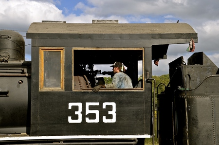 ROLLAG, MINNESOTA, Sept 1. 2016: An old restored train steam powered locomotive pulling a coal car is displayed at the West Central Steam Threshers Reunion in Rollag, MN attended by 1000s held annually on Labor Day weekend. Editorial
