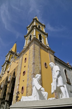 Magnificent downtown Cathedral in Mazatlan, Mexico with statues in front which was built from  1875 to 1899 and remains as a tourist attraction