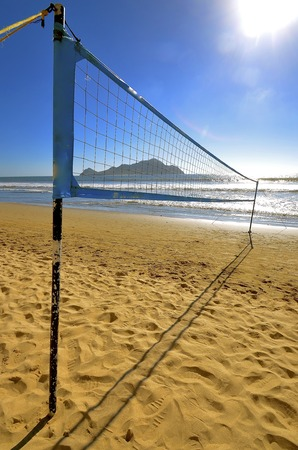 meshed: Beach volleyball in the sand of Mazatlan, Mexico with the island in the background Stock Photo