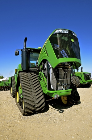 WEST FARGO, NORTH DAKOTA, September 13, 2016:  The new 9620RX JohnDeere tractor is being displayed at the West Fargo Big Iron Farm Show, a display of modern farm and agricultural equipment held at the Red River Valley Fairgrounds each 2nd week of Septembe Editorial