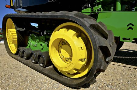 The track of a new tractor which replaces the traditional two round wheels