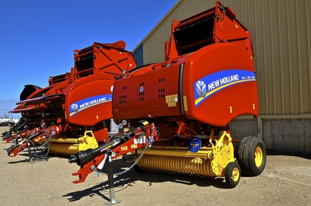 WEST FARGO, NORTH DAKOTA, SEPT. 13, 2016: The New Holland roll belt balers displayed at the Big Iron Machinery exhibit in West Fargo, ND are products of global brand of agricultural machinery produced by CNH Industrial manufacturing tractors, combines, ba