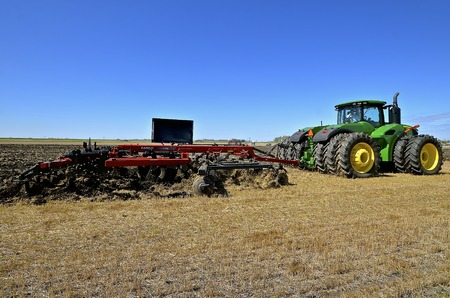 WEST FARGO, NORTH DAKOTA, September 13, 2016. A new John Deere tractor and Case IH chisel plow are demonstrating usage at the annual Big  Iron Farm Show located at the Red River Fairgrounds.