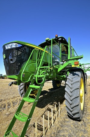 WEST FARGO, NORTH DAKOTA, September 13, 2016. A new John Deere computerized spraying tractor and booms is doing a field demonstration on usage at the annual Big Iron Farm Show located at the Red River Fairgrounds.