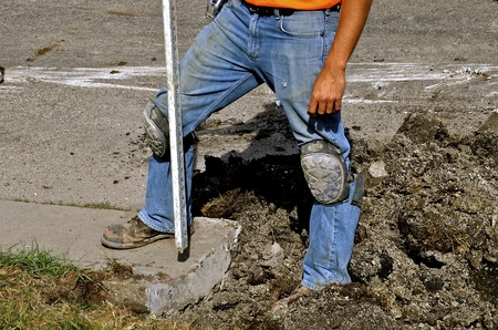 Process of measuring elevation and grade on a street curb construction project in the process of establishing  grade.