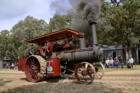 traction engine: ROLLAG, MINNESOTA, Sept 1. 2016: A restored Gaar Scott steam engine billowing black smoke is being driven in the parade  at the annual WCSTR farm show in Rollag held each Labor Day weekend where 1000s attend.