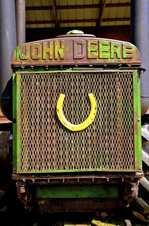 ROLLAG, MINNESOTA, Sept 2, 2016: An old John Deere tractor with a horse shoe in the grill is displayed at the WCSTR in Rollag held annually each Labor Day where thousands attend.