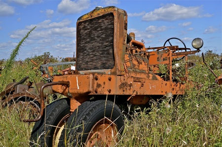 BARNESVILLE, MINNESOTA, September 14, 2014: The worn out tractor was from the company of Allis Chalmers, a manufacturer of machinery for various industries including agricultural equipment, construction, power generation, and power transmission and is pre