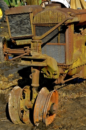 corroded: BARNESVILLE, MINNESOTA, March 30 2017: The old rusty tractor is a Fordson a brand name of tractors used on a range of general-purpose tractors manufactured by Henry Ford.