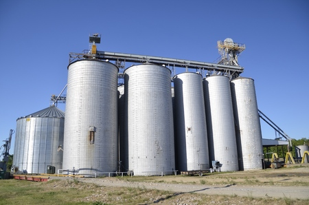augers: Cluster of grain elevators for storing and drying grain