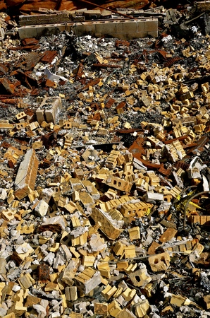 Broken bricks, charred metal and ashes are all which remain after a warehouse fire.