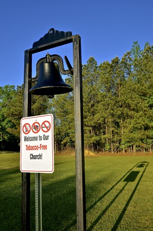 A metal sign with the message of Welcome to our Tobacco Free Church greets visitors