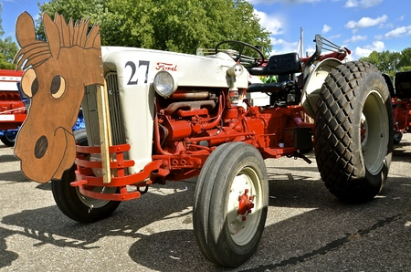 YANKTON, SOUTH DAKOTA, August 19, 2106: A Restored Ford N Series tractor is displayed at the annual Riverboat Days celebrated the third weekend of August in Yankton, South Dakota.