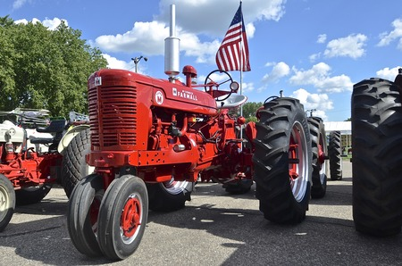 YANKTON, SOUTH DAKOTA, August 19, 2106: A Restored  Farmall  Suoer M bearing the American flag is displayed at the annual Riverboat Days celebrated the third weekend of August in Yankton, South Dakota. Editorial