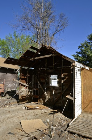 rafters: An old garage is in the process of demolition