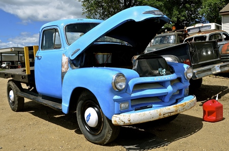 LAKE PARK, MINNESOTA, August 4, 2017: The old pickup with an open hood from the 40`s is a Chevrolet, colloquially referred to as Chevy and formally the Chevrolet Division of General Motors Company, is an American automobile division of the American manufa